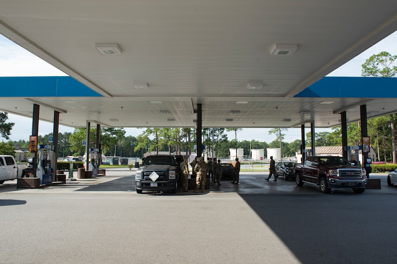 A photo of sergeants pumping gas for Airmen.