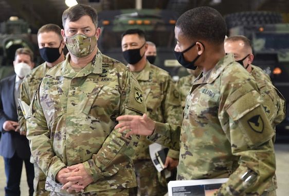 Col. Wheeler R. Manning, commander, 403rd Army Field Support Brigade, briefs Lt. Gen. Willard M. Burleson III, commanding general, Eighth Army, on the brigade's diverse mission set at Camp Carroll, South Korea, Oct. 6.