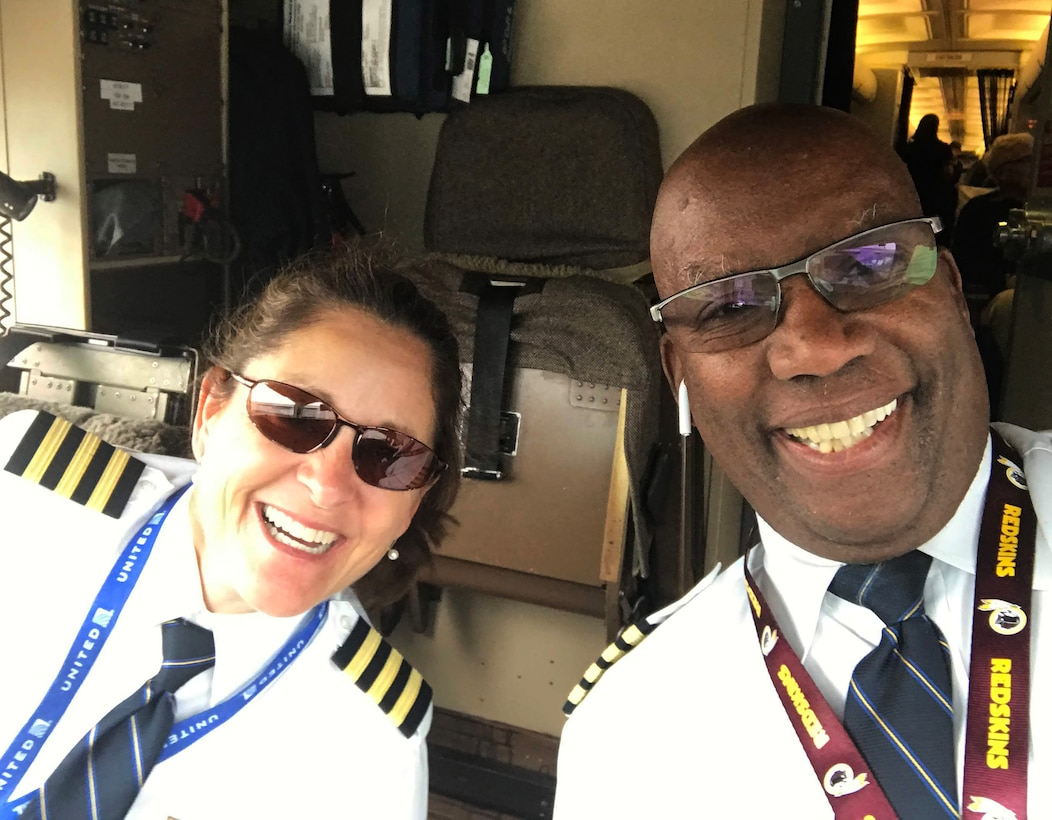 Col. Leslie Hadley, 403rd Wing vice commander, and retired Lt. Col. Karl MInter enjoy a moment on the flight deck of the Boeing 757 before take-off in their profession as United Airlines pilots. (Courtesy photo by Col. Leslie Hadley)