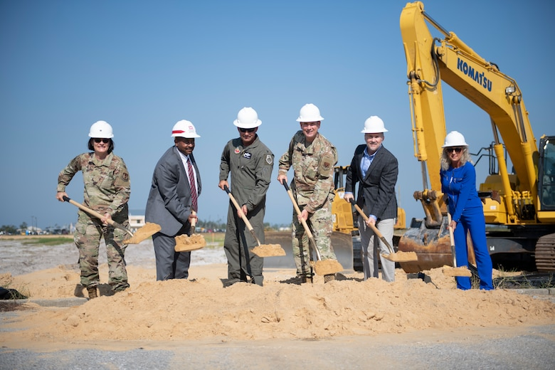 group of people shoveling dirt
