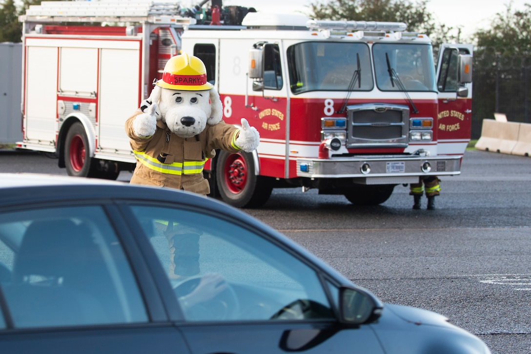Sparky the Fire Dog from the 423rd Civil Engineer Squadron welcomes drivers to RAF Molesworth, England, Oct. 6, 2020 during Fire Prevention Week 2020. 423rd CES Fire and Emergency Services is dedicated to the safety and well-being of everyone who lives, works or plays on our installations. (U.S. Air Force photo by Senior Airman Jennifer Zima)