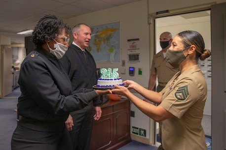The 19th Sergeant Major of the Marine Corps, Sgt. Maj. Troy E. Black and his staff deliver a birthday cake to the Master Chief Petty Officer of the Navy Russell Smith office, Washington DC, Oct. 13, 2020. The cake was delivered to celebrate the Navy's 245th birthday. The Navy and Marine Corps team continues to define the future character of maritime concepts and remains a ready to respond to an increasingly complex and dangerous world. (U.S. Marine Corps photo by Sgt. Victoria Ross)