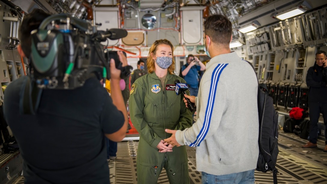 Staff Sgt. Kori Myers, 418th Flight Test Squadron C-17 load master, is interviewed by a local news agency prior to a media flight during the 2020 Aerospace Valley Air Show at Edwards Air Force Base, Oct. 9. (Air Force photo by Giancarlo Casem)