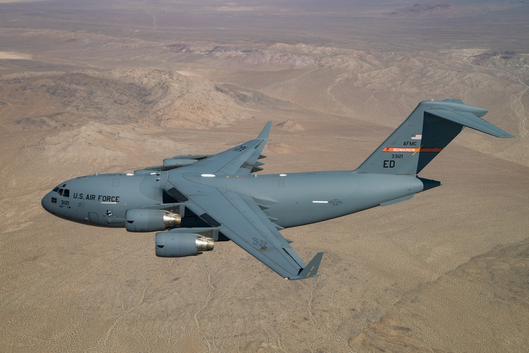 A C-17 Globemaster III assigned to the 418th Flight Test Squadron, 412th Test Wing, flies over the Mojave Desert during the 2020 Aerospace Valley Air Show at Edwards Air Force Base, Oct. 10. (Air Force photo by Christian Turner)