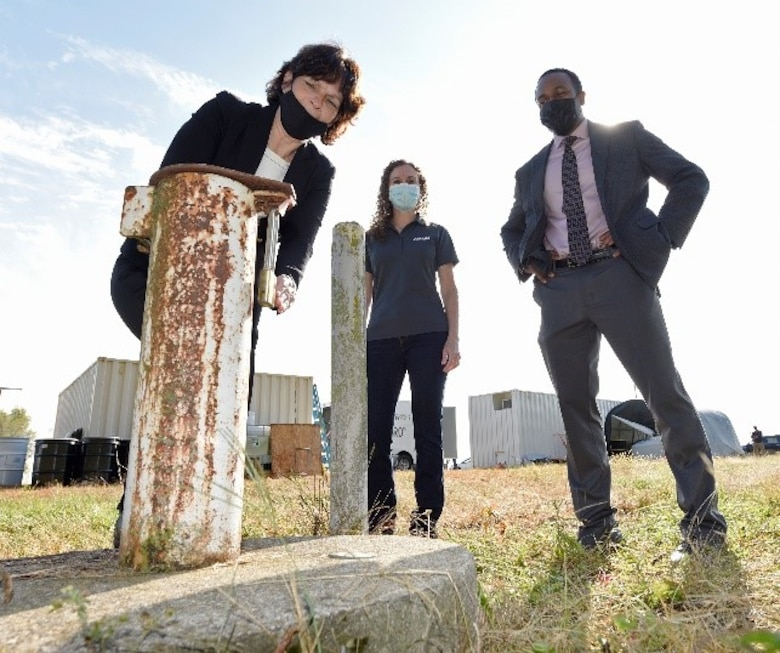 From left, Treva Bashore, restoration program manager, AFCEC/CZOM Civil Engineer Center, Rebecca Mora, project manager, AECOM, and Amir Mott, deputy director, 88th Civil Engineer Group,  discuss where the PFAS-contaminated groundwater was extracted at the fire training area of Wright-Patterson Air Force Base, Ohio on Sept. 29, 2020. U.S. Air Force personnel from the Air Force Civil Engineer Center are leading a pilot study of new remediation techniques that can remove and destroy per- and polyfluoroalkyl substances (PFAS) from contaminated groundwater. PFAS is a group of chemicals, some of which were formerly used in aircraft fire fighting foam. (U.S. Air Force photo by Ty Greenlees)