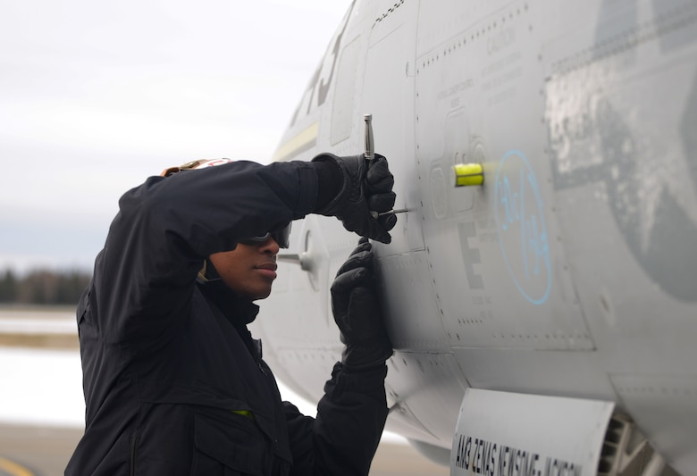A U.S. Navy aircraft mechanic assigned to the Electronic Attack Squadron (VAQ) 132 tightens a rivet on an EA-18G Growler during RED FLAG-Alaska 21-1 on Eielson Air Force Base, Alaska, Oct. 13, 2020. Across all branches of the U.S. military, aircraft maintenance requires the utmost attention to detail to ensure that all jets are safe and ready to fly at a moment's notice. (U.S. Air Force photo by Senior Airman Beaux Hebert)