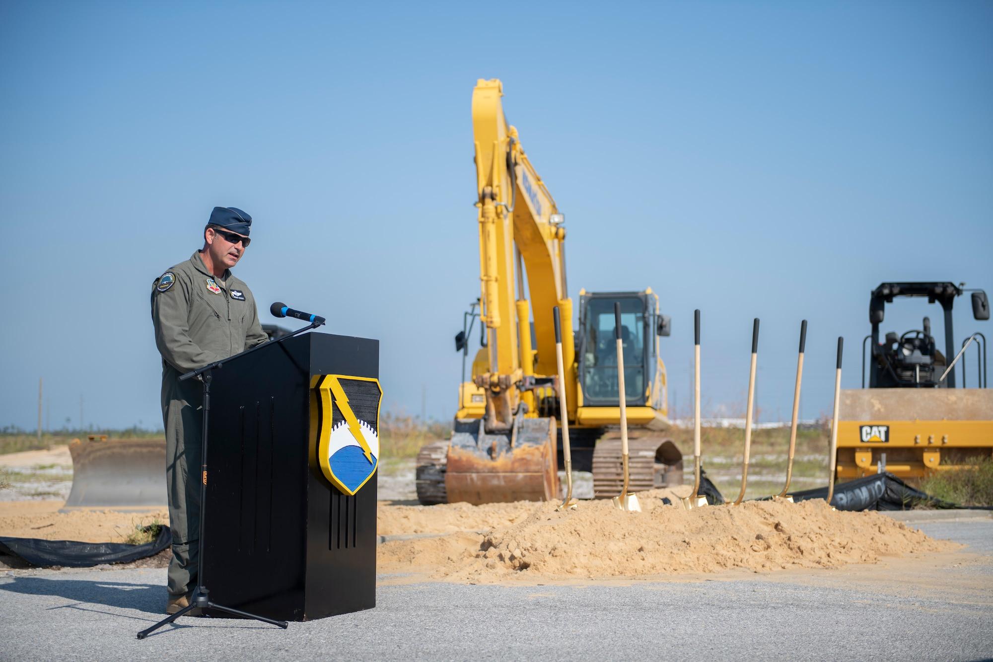 man speaks from podium