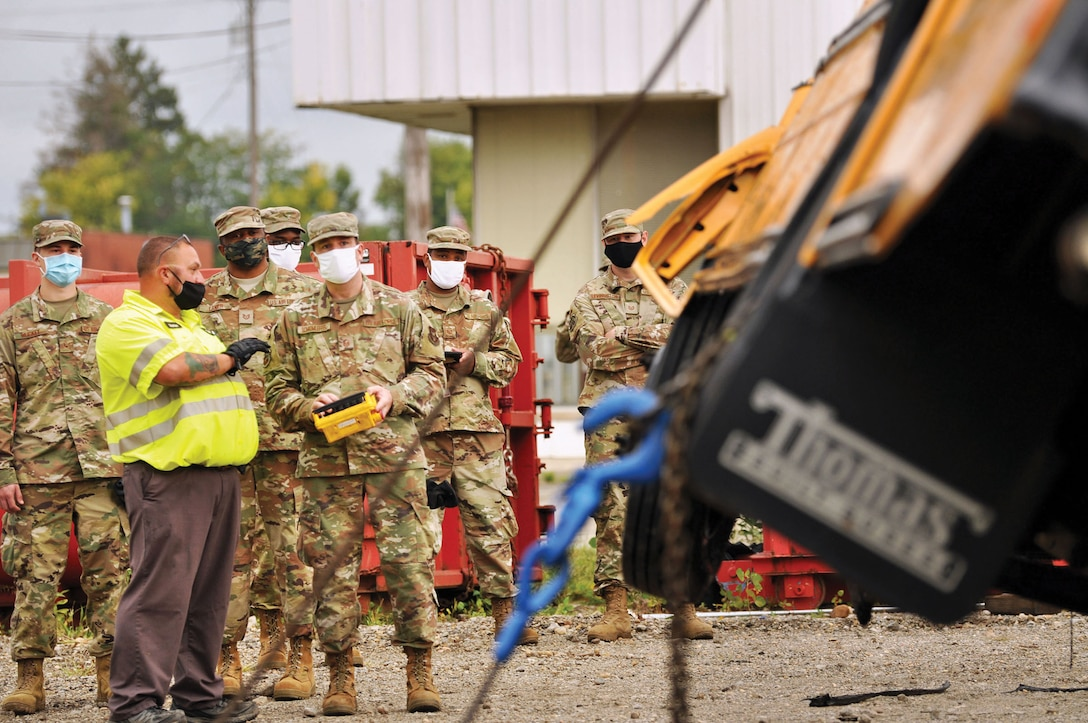 Reserve Citizen Airmen from the 445th Logistics Readiness Squadron perform recovery training on a 44-passenger bus at Sandy's Towing, Recovery & Carrier Service in Dayton, Ohio, Sept. 13, 2020. Airmen gained hands on training of proper and safe use of wrecker vehicles and recovery procedures.