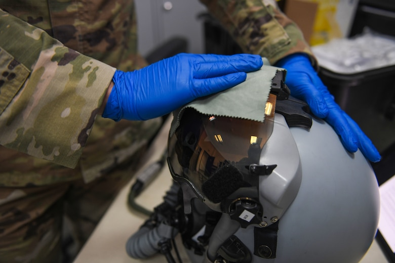 Airman 1st Class Matthew Giordano, 31st Operations Support Squadron aircrew flight equipment technician, cleans a display unit visor during NATO enhanced Air Policing at Graf Ignatievo Air Base, Bulgaria, Oct. 13, 2020. During NATO eAP Giordano is responsible for inspecting and maintaining life-saving equipment to include oxygen masks, life preservers, survival masks, anti-exposure suits, radios and recovery kits. (U.S. Air Force photo by Airman 1st Class Ericka A. Woolever)