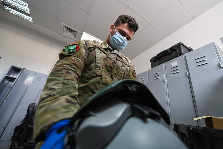 Airman 1st Class Matthew Giordano, 31st Operations Support Squadron aircrew flight equipment technician, inspects a display unit visor during NATO enhanced Air Policingat at Graf Ignatievo Air Base, Bulgaria, Oct. 13, 2020. During NATO eAP Giordano performed a pre-flight inspection to each piece of equipment used during the flying day. (U.S. Air Force photo by Airman 1st Class Ericka A. Woolever)