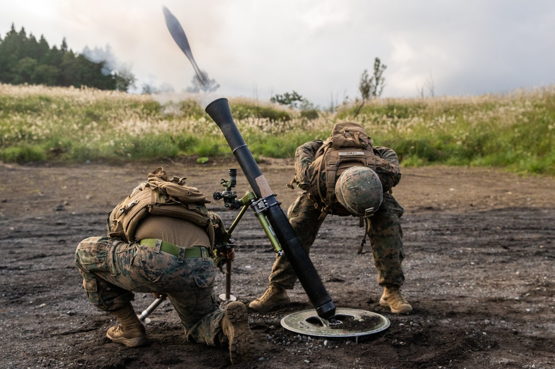 U.S. Marines fire an M252A2 81mm mortar at a live-fire mortar displacement range at Combined Arms Training Center, Camp Fuji, Japan, Oct. 1.
