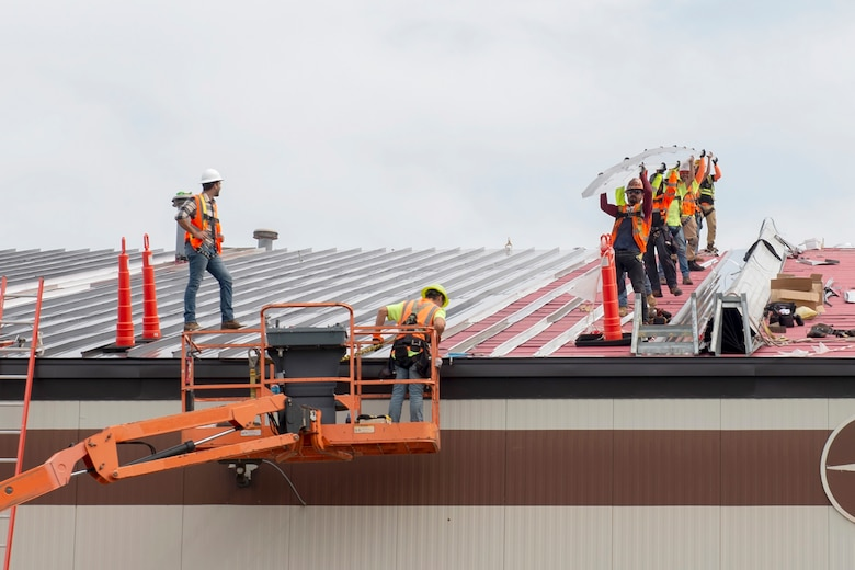 Contractors replace the roof of Dock 1 at Grissom Air Reserve Base, Indiana, Sept. 23, 2020. Repairing the dock roofs are part of the many projects the 434th Civil Engineering are working on throughout Grissom. (U.S. Air Force photo by Staff Sgt. Michael Hunsaker)