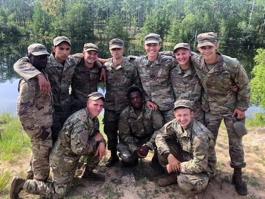 New York Army National Guard Pfc. Jason Snyder, standing at center, marks his completion of the U.S. Army Ranger Course with fellow Rangers Aug. 27, 2020, at Fort Benning, Georgia.
