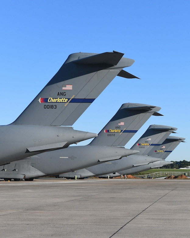 Five C-17 Globemaster III Aircraft belonging to the 145th Airlift Wing are parked in a row on a sunny day at the  North Carolina Air National Guard Base, Charlotte Douglas International Airport, October 14, 2020. The 145th Airlift Wing began converting from C-130 Hercules to the C-17 in October of 2017 and officially exited conversion in October 2020.