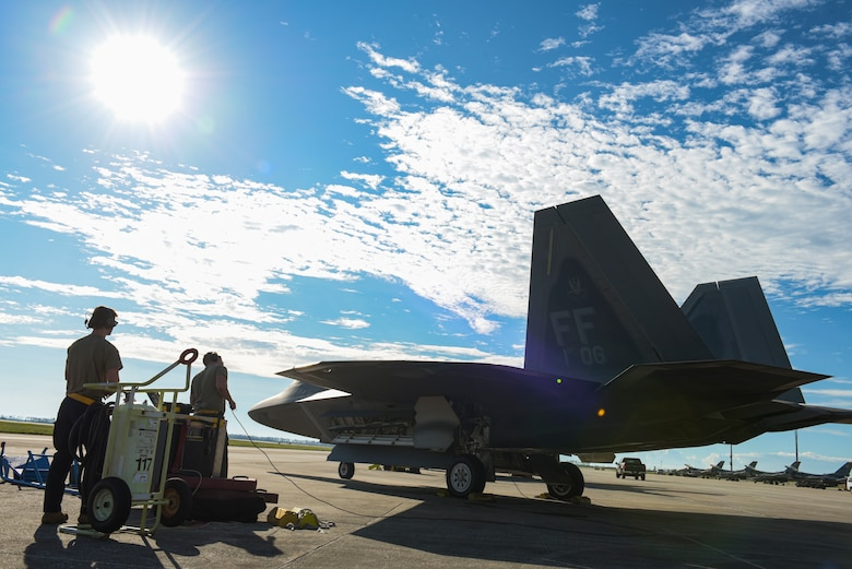 U.S. Air Force maintainers perform pre-flight checks on an aircraft.
