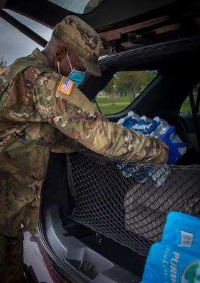 Texas Army National Guard members distribute water bottles to residents at Lake Jackson, Texas, Oct. 8, 2020, after a deadly amoeba affected the water supply.