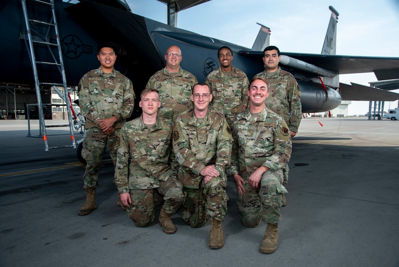 389th Fighter Squadron weapons load crew members pose in-front of an F-15E Strike Eagle, Oct. 8, 2020, at Mountain Home Air Force Base, Idaho. Integrated Combat Turns are a rapid re-arming and refueling practice where both fuels and weapons troops work side-by-side to turn aircraft around and get them back into the skies. (U.S. Air Force photo by Senior Airman JaNae Capuno)