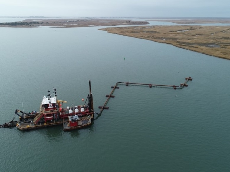 The Dredge Fullerton, owned and operated by Barnegat Bay Dredging Company, conducts dredging in the New Jersey Intracoastal Waterway near Stone Harbor, N.J. as part of a U.S. Army Corps of Engineers project. The sediment was placed to create habitat on marshland managed by the New Jersey Division of Fish & Wildlife.