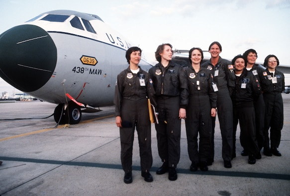 Picture of  7 seven in flight suits standing in front of a C-141.