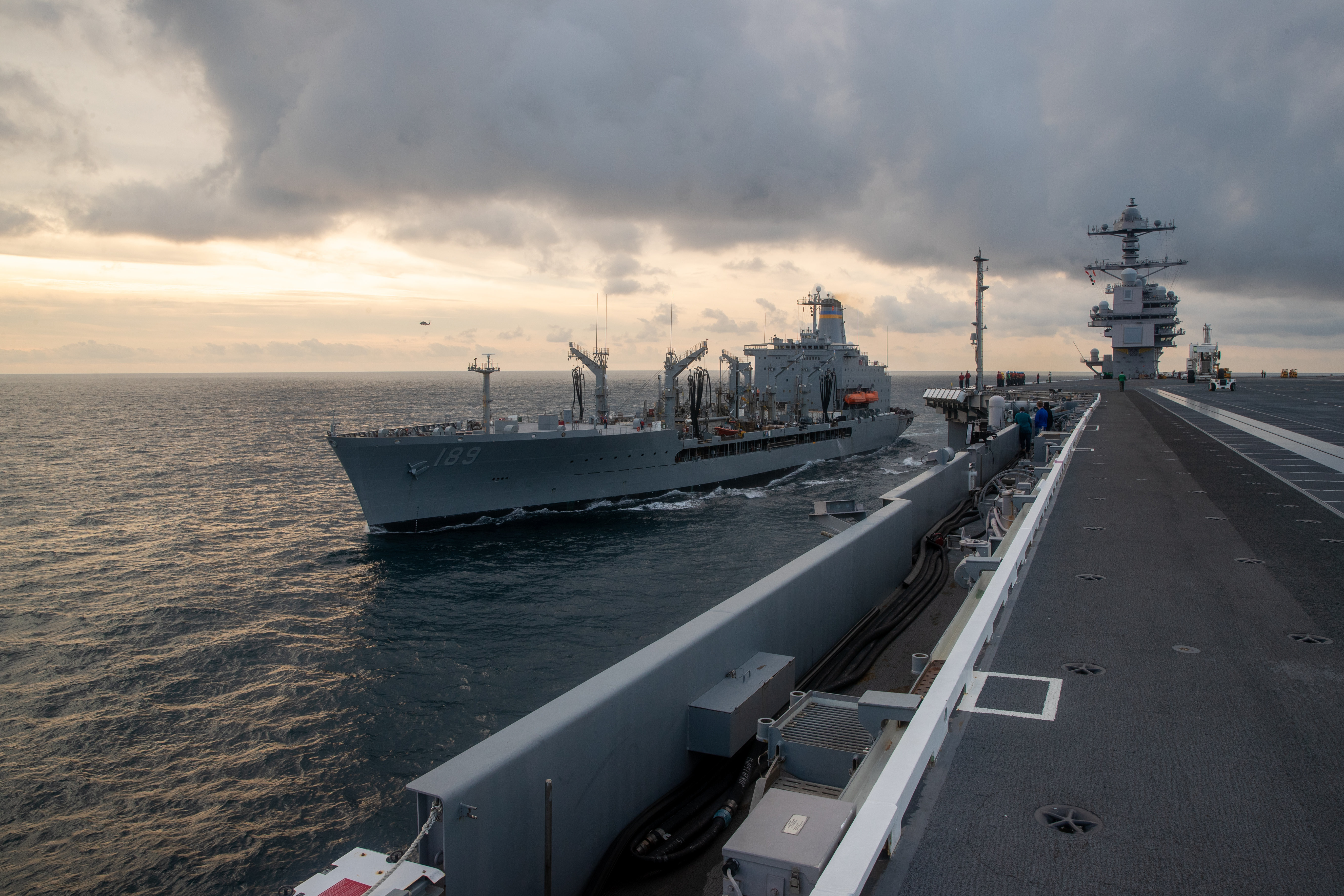USNS John Lenthall and USS Gerald R. Ford conduct a vertical replenishment-at-sea