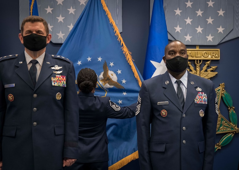 U.S. Air Force Lt. Gen. Michael A. Loh, Air National Guard (ANG) director, and Chief Master Sgt. Maurice L. Williams stand at attention while the ceremonial Air National Guard flag is posted during an assumption of responsibility ceremony at the Pentagon in Arlington, Va., Oct. 9, 2020. During this ceremony, Williams assumed the role as the 13th command chief of the ANG. (U.S. Air National Guard photo by Tech. Sgt. Morgan R. Lipinski)