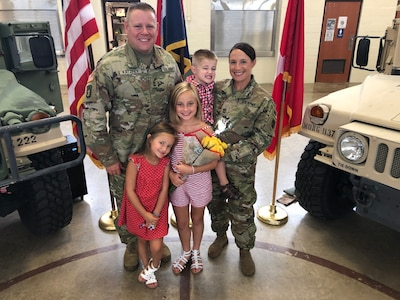 1st SGT David Katzfey and 1st SGT Trisha Katzfey, both of the Missouri Army National Guard, pose for a quick family photo.