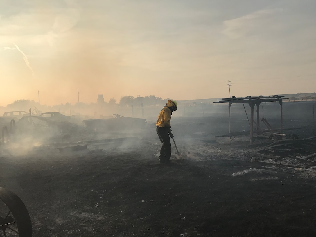 A fire fighter responds to a wildland fire Oct. 8, 2020, near Fort Shaw, Mont.