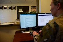 Picture of Airmen reviewing vehicle rental form