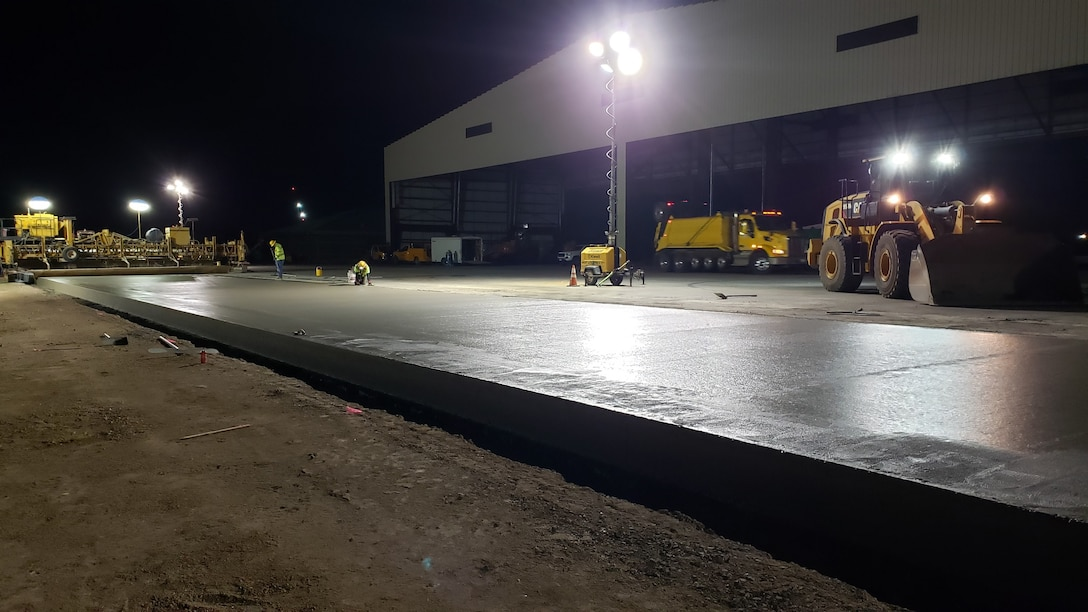 Contractors check the edging of a convrete test lane poured  on Sept. 1 for the Joint Base Pearl-Harbor Hickam F-22 Fighter Alert Facility project.