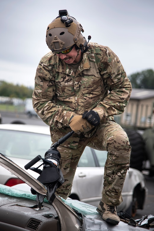 "An Oregon Air National Guardsman from the 125th Special Tactics Squadron, uses a tool called the ""jaws of life"" to conduct extrication training at Portland Air National Guard Base, Portland, Ore., Oct. 8, 2020. Extrication training helps members understand how to remove trapped personnel from crashed aircraft or vehicles. (U.S. Air National Guard photo by Senior Airman Valerie R. Seelye)"