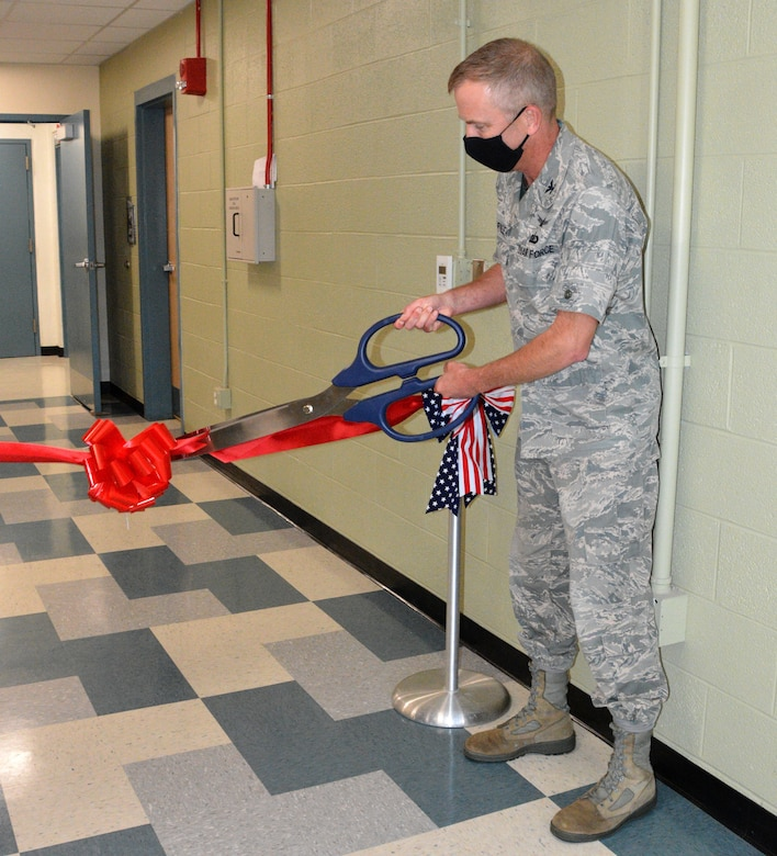 Col. Michael Warner, acting AFRL Materials and Manufacturing Directorate director, cuts a ceremonial ribbon during the grand opening of the new Special Test and Research, or STAR Lab, September 25. Courtesy photo.