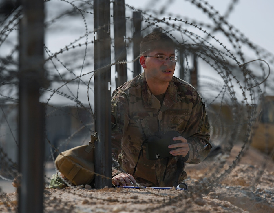 U.S. Air Force Tech. Sgt. Austin Medina, 22nd Expeditionary Weather Squadron non-commissioned officer in charge, observes the area at Camp Buehring, Kuwait, Oct. 2, 2020.