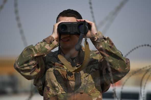 U.S. Air Force Tech. Sgt. Austin Medina, 22nd Expeditionary Weather Squadron non-commissioned officer in charge, uses a laser rangefinder at Camp Buehring, Kuwait, Oct. 2, 2020.
