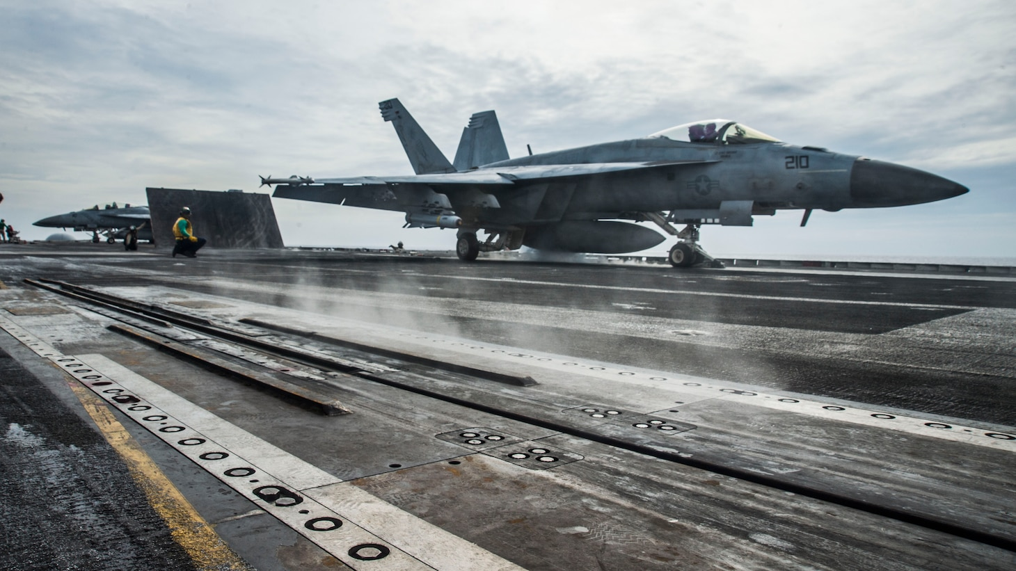 "An F/A-18E assigned to the ""Royal Maces"" of Strike Fighter Squadron (VFA) 27 launches off the flight deck of the aircraft carrier USS Ronald Reagan (CVN 76) while conducting security and stability operations in the South China Sea. Ronald Reagan, the flagship of Carrier Strike Group 5, provides a combat-ready force that protects and defends the U.S. as well as the collective maritime interests of its allies and partners in the Indo-Pacific."