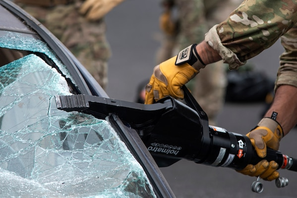 "A member of the Oregon Air National Guard's 125th Special Tactics Squadron uses the ""jaws of life"" tool to conduct extrication training at Portland Air National Guard Base, Portland, Ore., Oct. 8, 2020. The training allowed members to use specialty tools in a controlled environment."