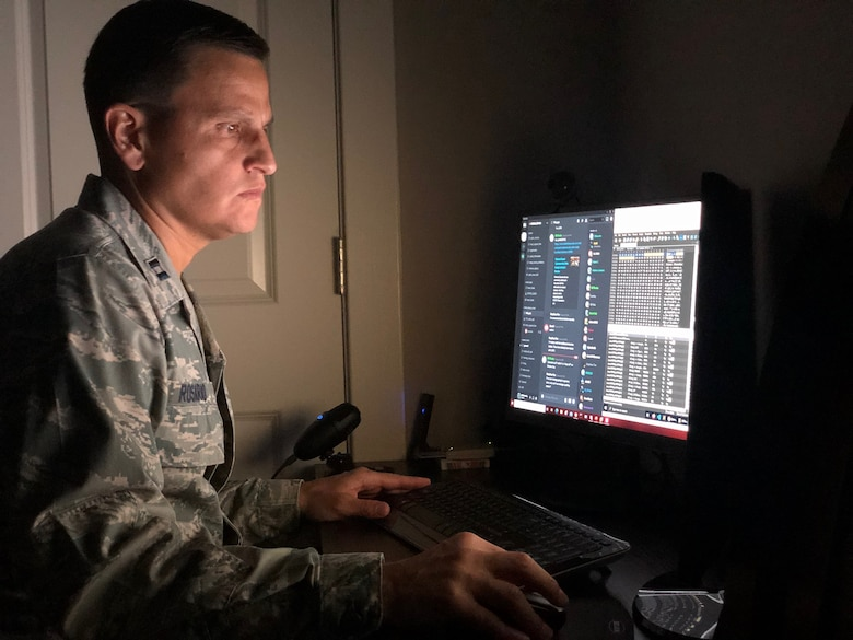 U.S. Air Force Capt. Miguel Rosario, a cyber operator assigned to the 276th Cyber Operations Squadron, Maryland Air National Guard, works on his computer at home September 8, 2020, before participating in the Cyber Shield exercise. 800 National Guard cyber operators from more than 40 states and territories participated in Cyber Shield 20, a virtual training exercise designed to build their skills defending networks. (Courtesy Photo)