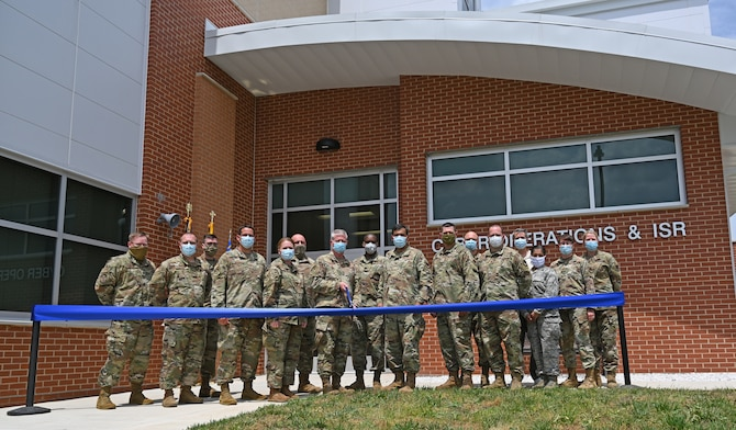 Leadership of the 175th Wing and 175th Cyberspace Operations Group attended a ribbon-cutting ceremony at Warfield Air National Guard Base, Middle River, Md., June 6, 2020. The ceremony marked the official opening of the new Cyberspace Operations Group and Intelligence, Surveillance, and Reconnaissance building at Warfield. (U.S. Air National Guard photo by Master Sgt. Christopher Schepers)