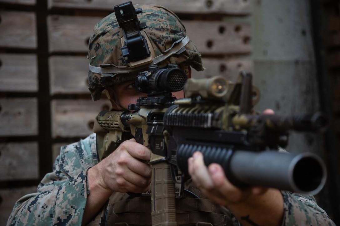 A U.S. Marine aims an M4-A1 Carbine during pistol and rifle transition dry runs aboard dock landing ship USS Germantown (LSD 42), Oct. 5.