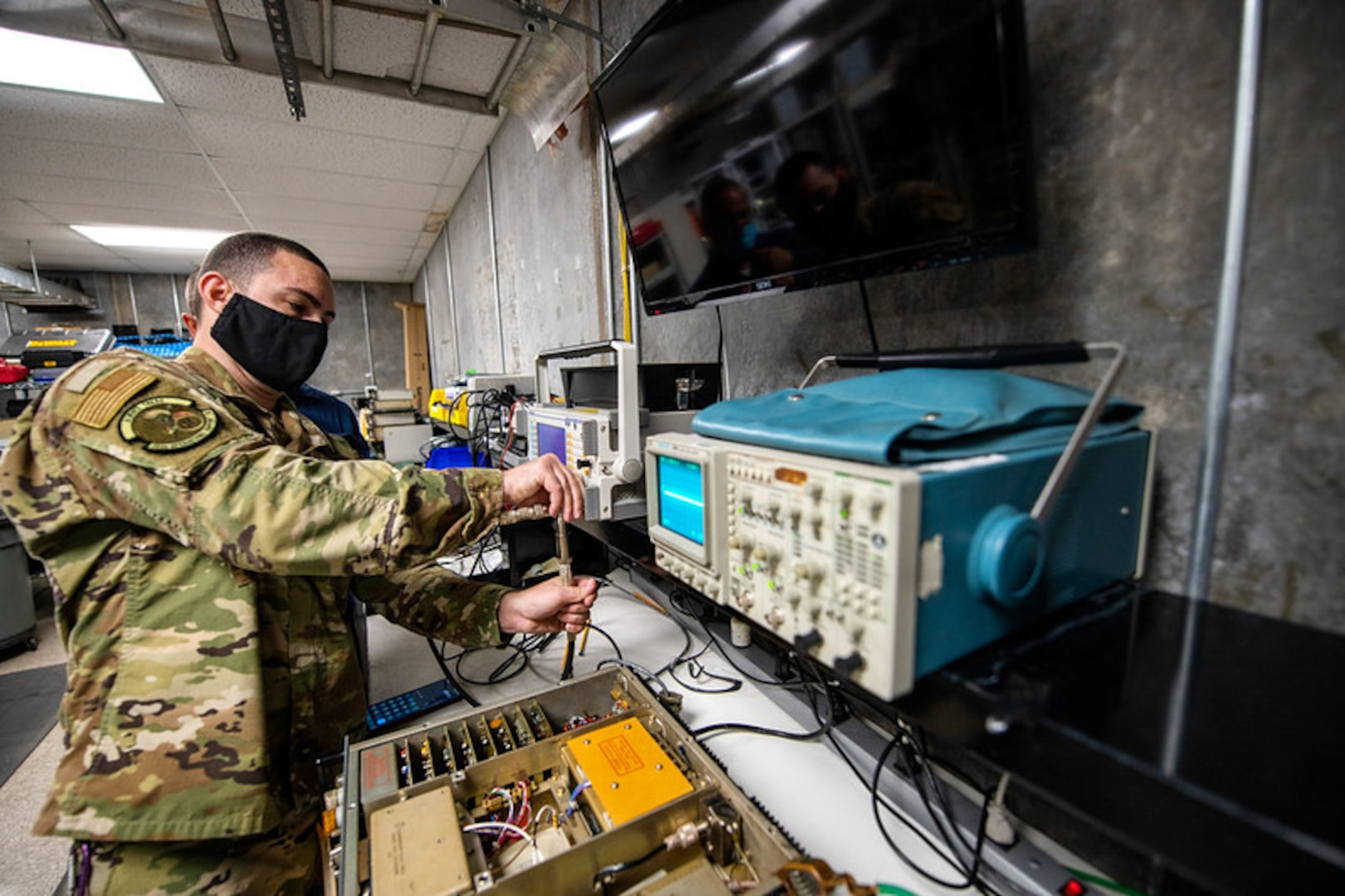U.S. Air Force Tech. Sgt. Joel Ruiz, 502nd Operations Support Squadron airfield systems supervisor, trouble shoots radio communications equipment in support of hurricane evacuation operations during hurricane Delta Oct. 7, 2020, at Joint San Antonio-Lackland, Texas.
