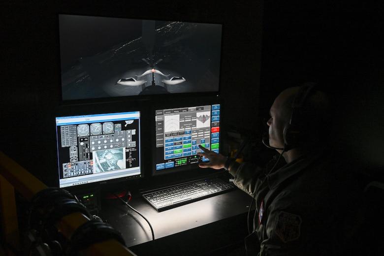 Boom operator changes settings on simulator.