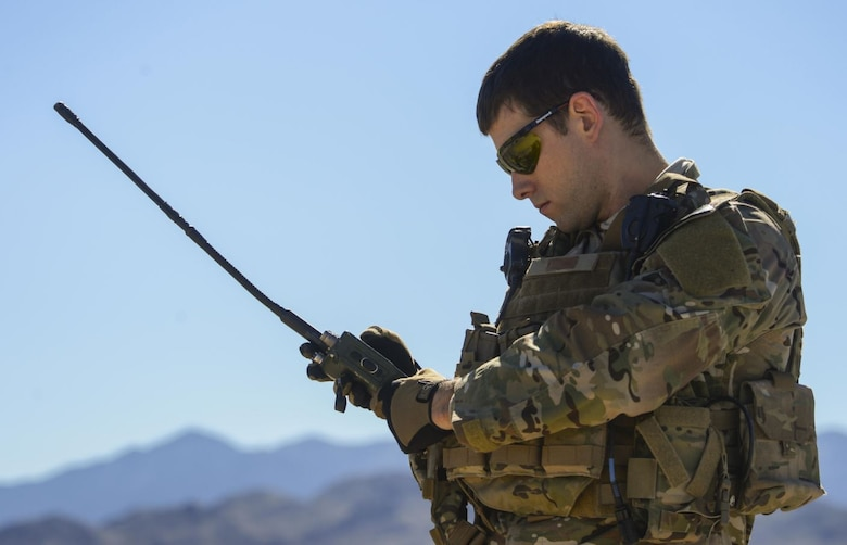 A joint terminal attack controller performs an operational assessment of a held radio at the Nevada Test and Training Range March 23, 2016. The Air-to-Ground, Tactical Data Links team at Hanscom Air Force Base, Mass. is currently working to upgrade radio technology across the services by providing an anti-jam, hack-proof, and high frequency radio system by 2024.