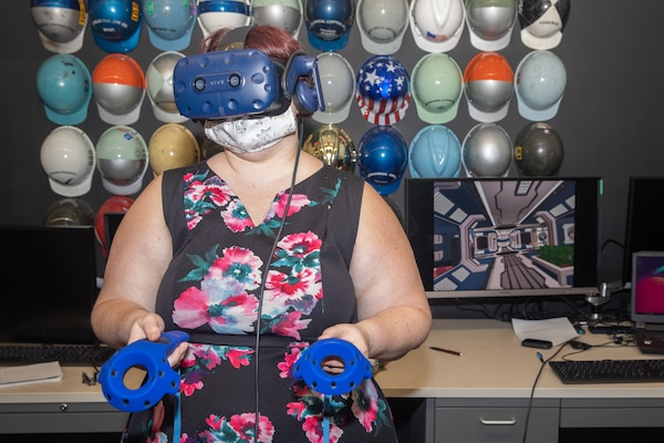 Public Affairs Specialist Kristi Britt test drives the virtual reality simulation in the NNSY Technology and Innovation Lab.