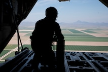 A photo of an Airman in the back of a C-130