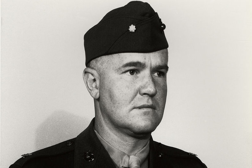 A man in a World War II uniform poses for a photo.