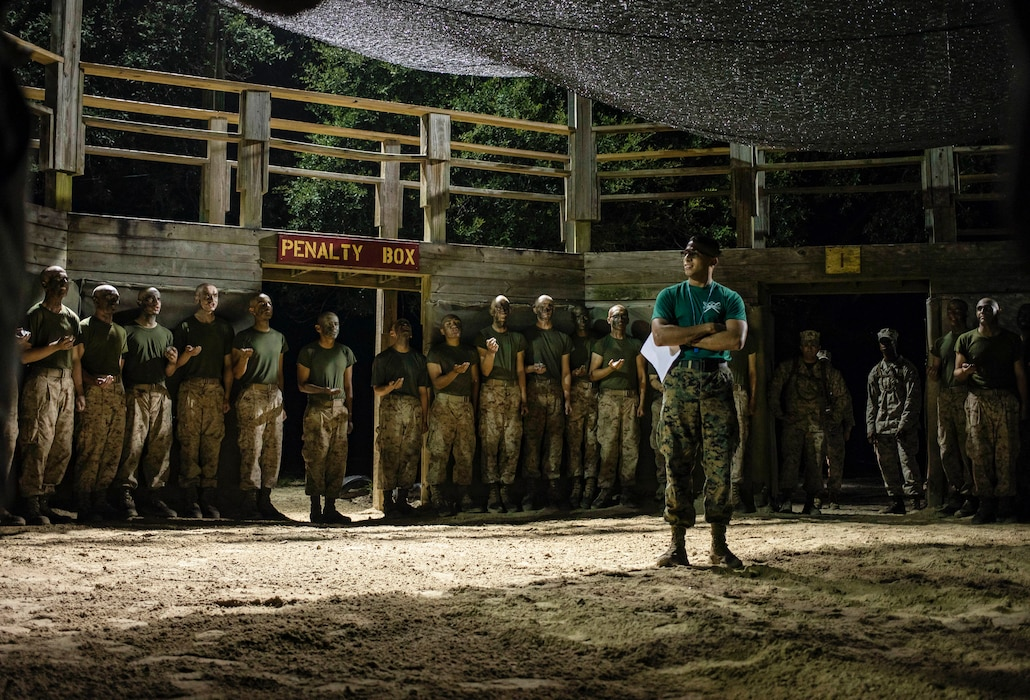 Recruits with Mike Company, 3rd Recruit Training Battalion, listen to instructions and their safety brief prior to Crucible boxing bouts on Marine Corps Recruit Depot Parris Island, S.C. Oct. 8, 2020. The Crucible is the final test of physical and mental endurance recruits will face before earning the title United States Marine, and is a culmination of all of the skills learned throughout recruit training.    (U.S. Marine Corps photo by Sgt. Dana Beesley)