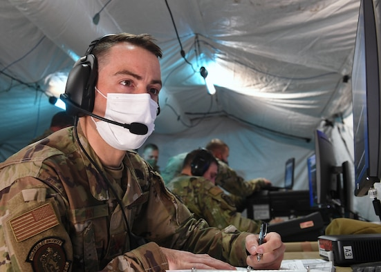 Maj. Dominic Perry, 379th Space Range Squadron, is Range Controlling during his first shift of Space Range Operations during the 379th SRS Field Training Exercise, Sept. 10-13, 2020, at the United States Air Force Academy's Field Engineering Readiness Laboratory, Colorado. (U.S. Air Force photo by Dennis Rogers)
