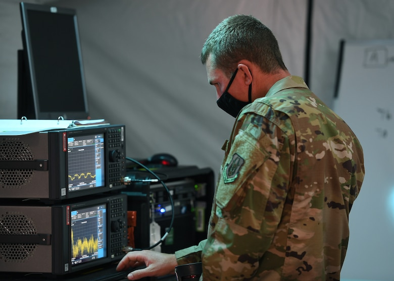 Staff Sgt. Shaun Gutierrez, 379th Space Range Squadron, calibrates the Spectrum Analyzer during the 379th SRS Field Training Exercise, Sept. 10-13, 2020, at the United States Air Force Academy's Field Engineering Readiness Laboratory, Colorado. (U.S. Air Force photo by Dennis Rogers)