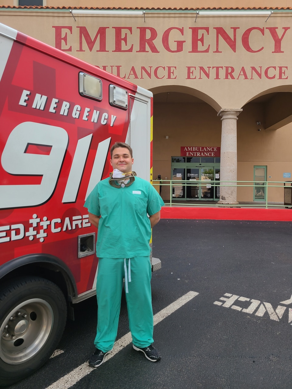 A man standing outside of a hospital.