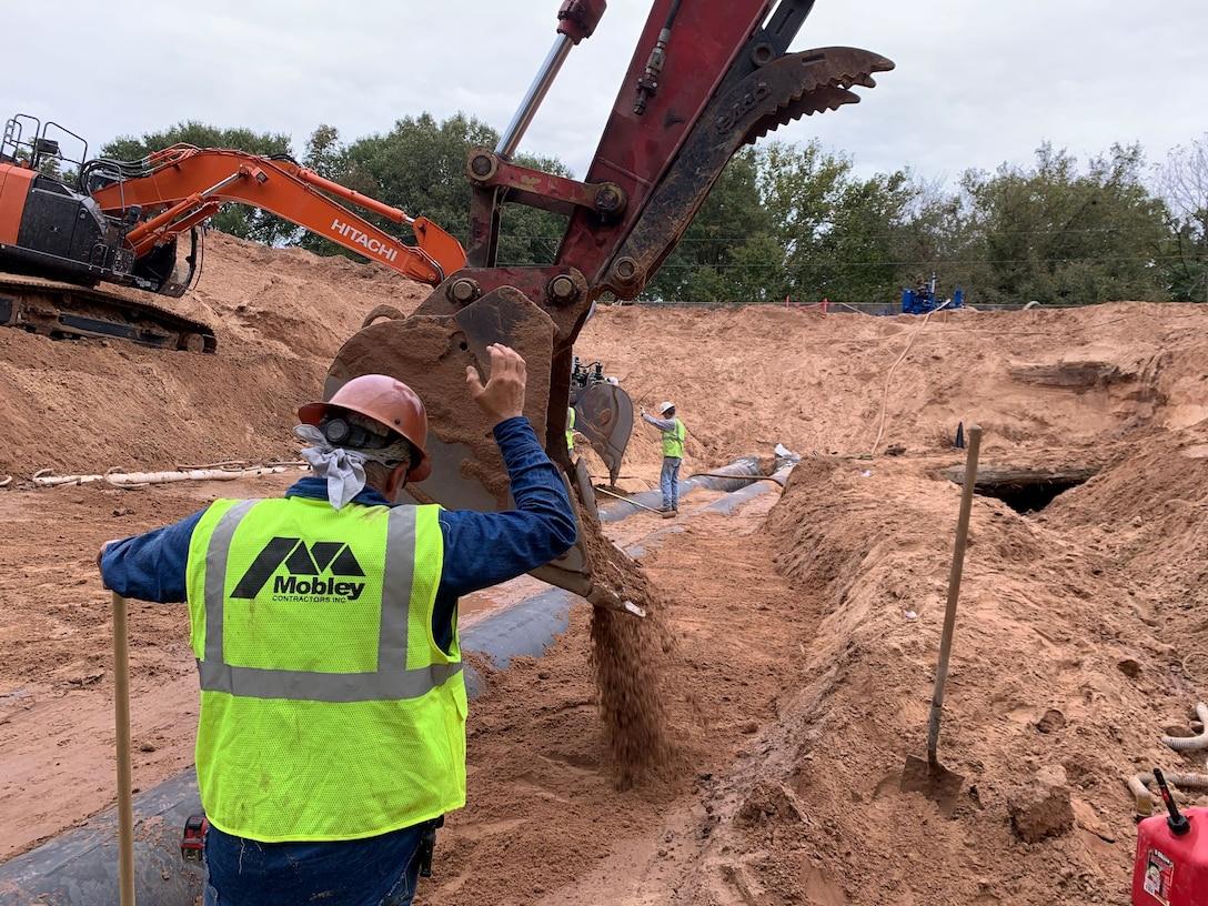 workers repairing a levee in Atkins, Arkansas