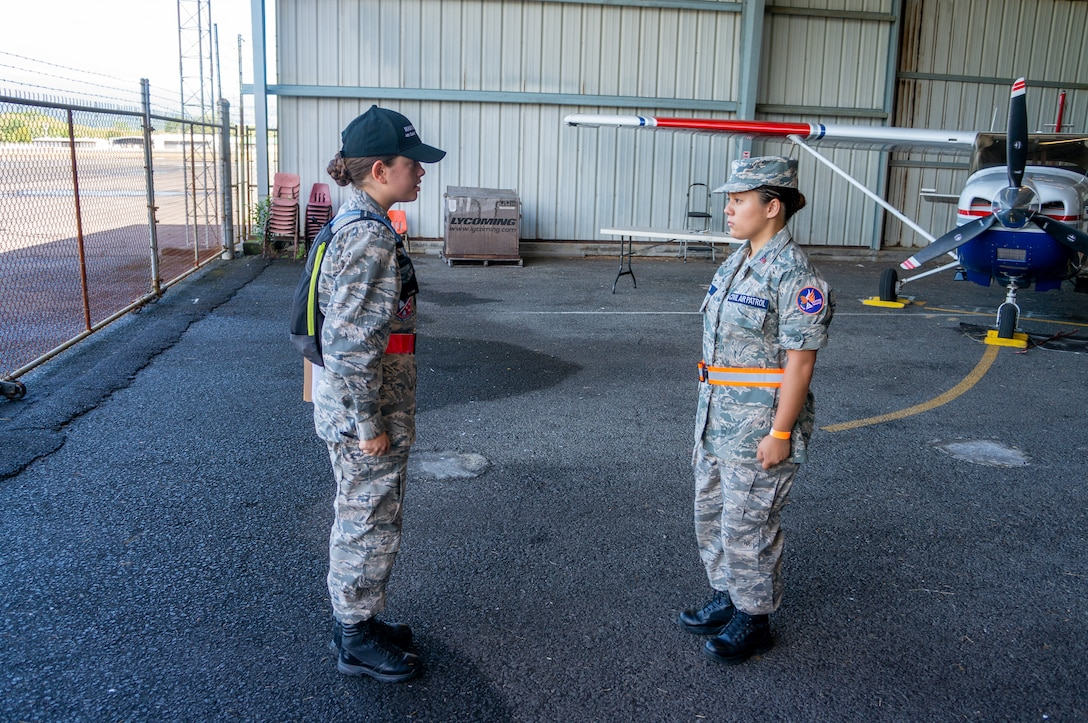Civil Air Patrol Cadet 2nd Lt. Jessica Cogan and Cadet Tech. Sgt. Zana Kimura, CAP Lyman Field Composite Squadron, check-in students at Kilauea Military Camp, Hawaii, July 20, 2019. Cadets participated in a six-day encampment to develop leadership skills and military discipline, and learn aerospace sciences. (Courtesy Photo)